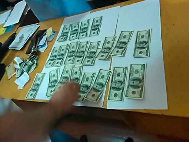 У Жашкові на хабарі в сумі 2 тис. доларів США затримано 27-річного чоловіка (фото)